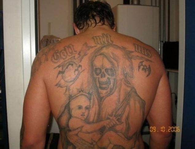 混合武术战斗机亚历山大·艾米连科的纹身破解?